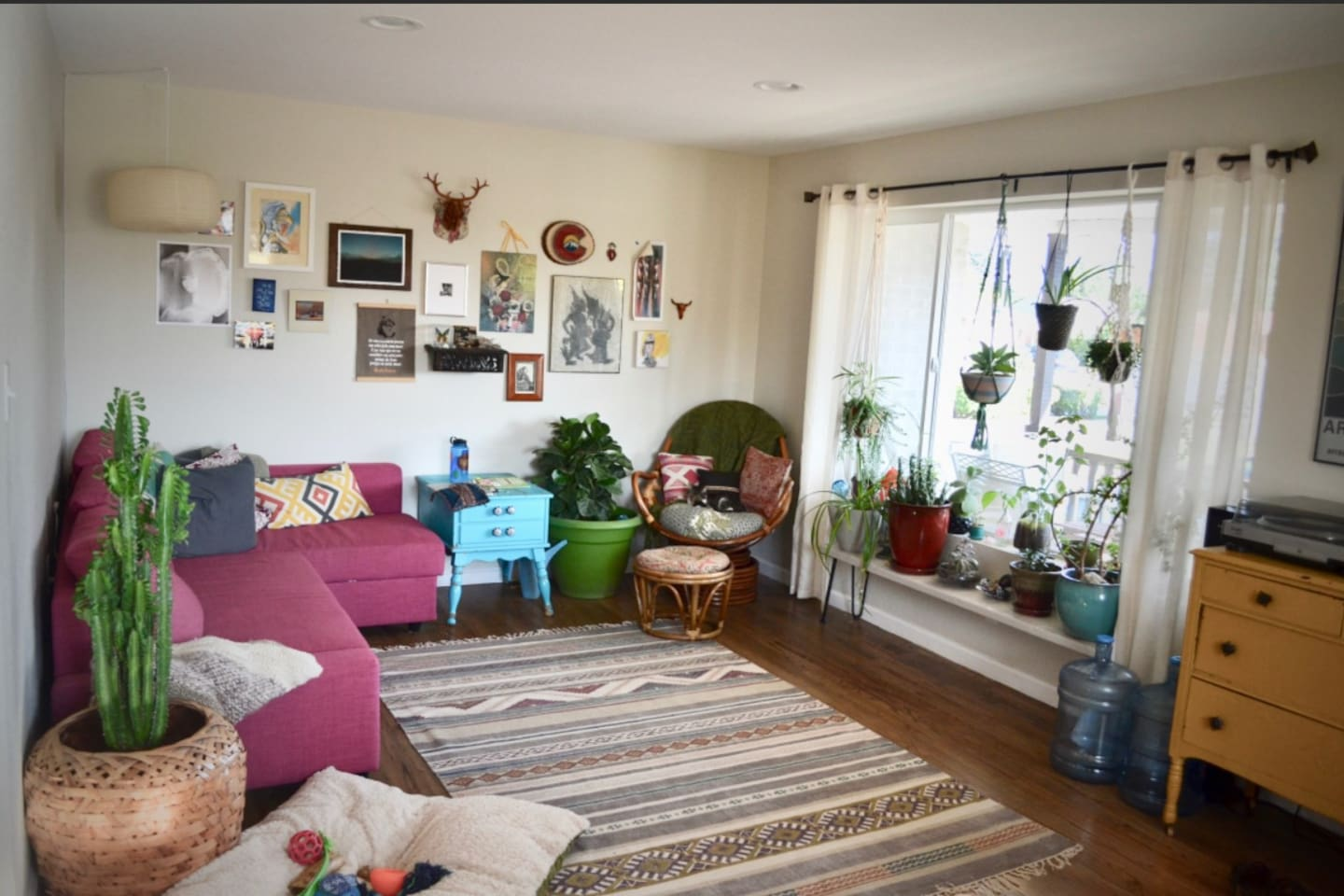 Our sunny living room is the perfect place to read or play a record!