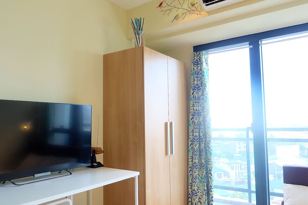 Besides being WiFi ready, Guests are also able to enjoy a flat screen TV equipped with basic cable, and a wardrobe cabinet to hang your clothes and store your belongings.