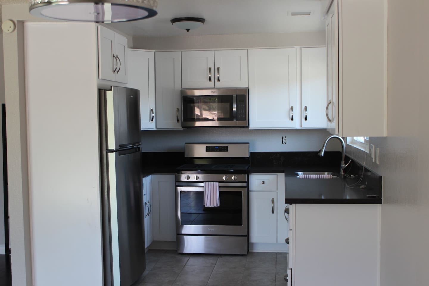Fully equipped kitchen w/ new appliances, pots, pans, dish washer, toaster, tea kettle and coffee maker.