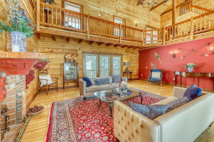 Stunning, creekside log home w/ gourmet kitchen, furnished deck, & views!