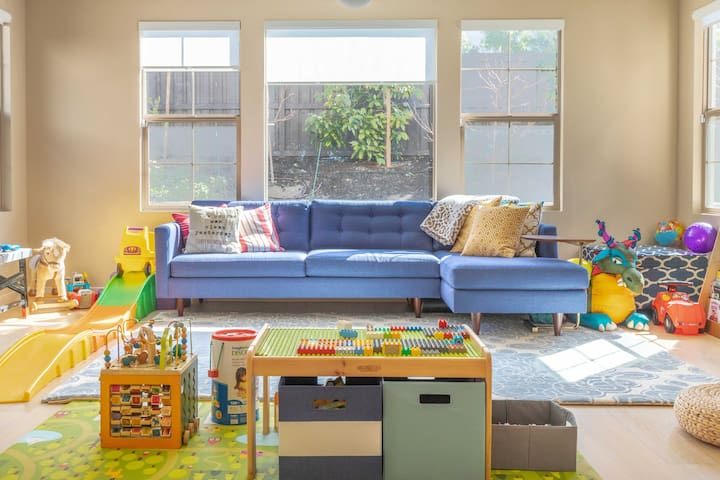 A second family area off kitchen that is kid heaven