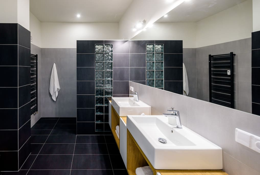 Luxuriously equipped bathroom with walk in shower will turn your showering ritual into a great experience.