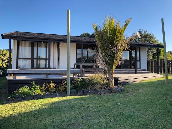 The Whiritoa Beach House - a sunny summer bach