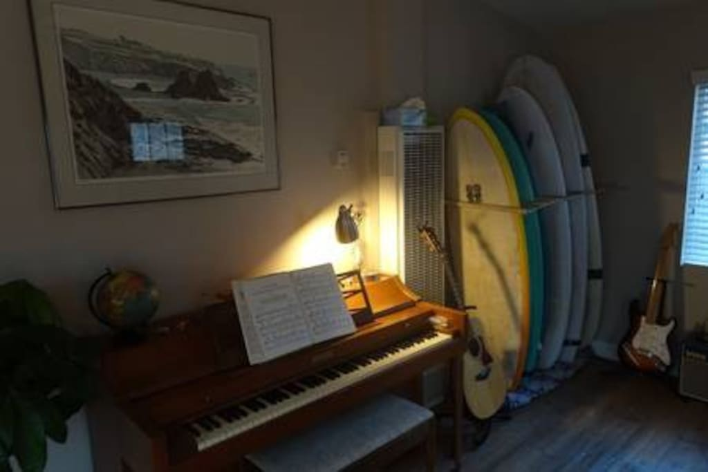 Piano and surfboard rack.