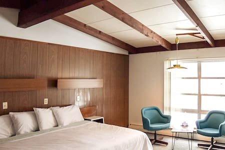 Clean and minimal midcentury design. Domestically produced linens, new mattresses and hardwood floors.