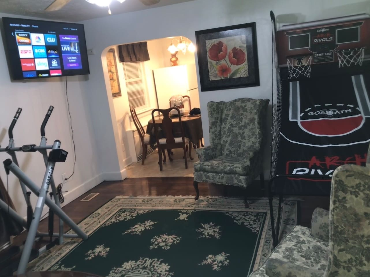 There's plenty to do Play single or multi player basketball on 8 ft. Electronic game  Put in  time working out on cross trainer.Enjoy a movie or show on 50 inch new ROKU tv Sit back relax and let google home mini entertain you just say hey google