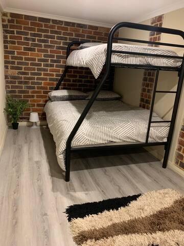 Downstairs bedroom & rumpus room
