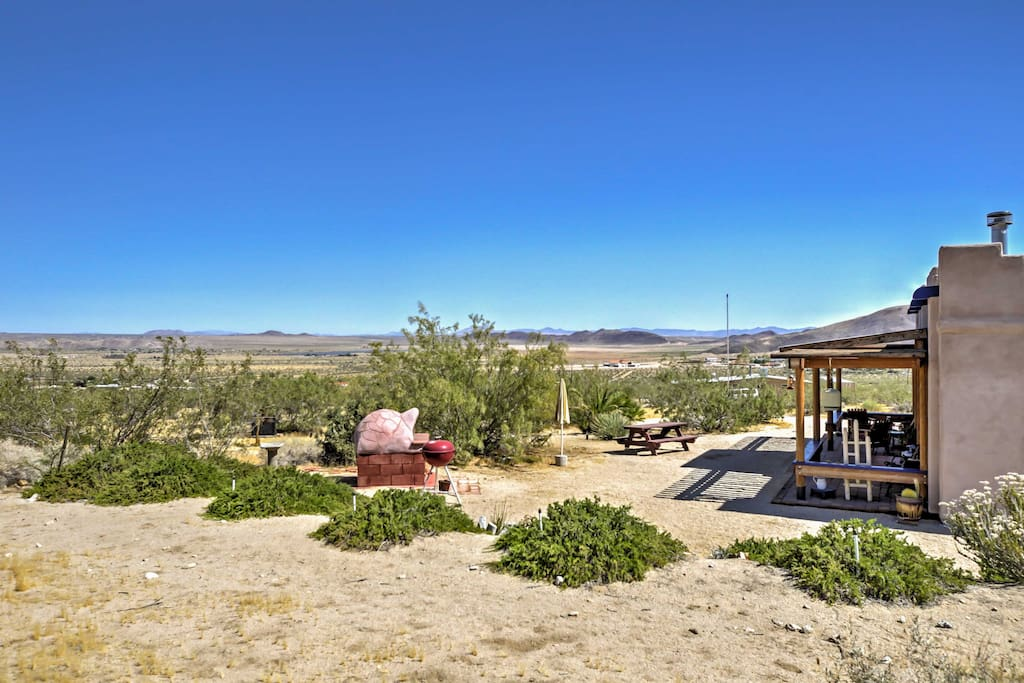 This adobe style home is situated on 2.5 acres of land and offers views of amazing rock formations and the Joshua Tree National Park.