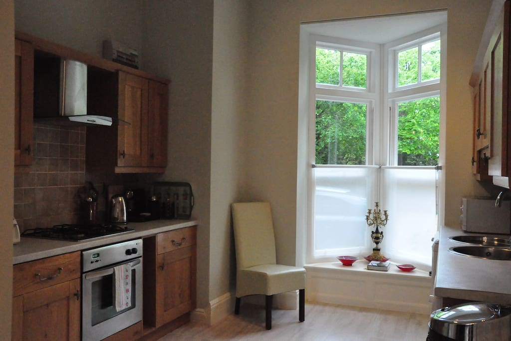 Large kitchen with washing machine, gas hob and electric fan oven