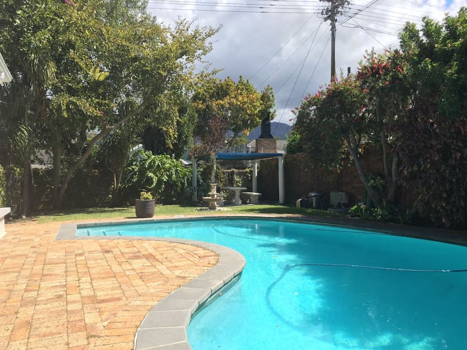 Large pool and outside area with BBQ and weber.