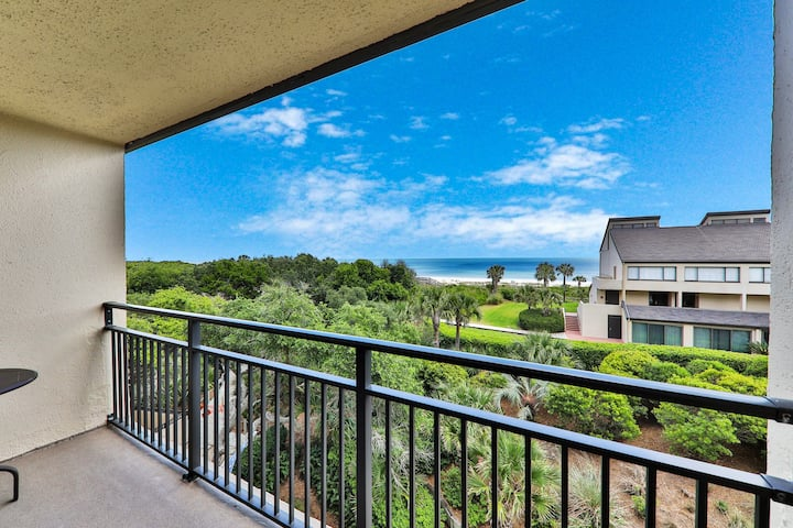Elegant ocean view townhome w/ beach access, shared pool & perfect location!
