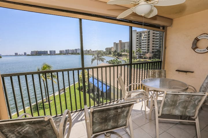 Stunning Sunrises and Panoramic Views of Estero Bay from a Beautifully Decorated, One Bedroom, Two Full Bath Waterfront Condo.