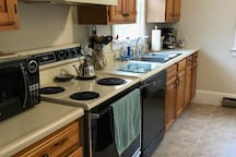 Full kitchen with everything you need, including a dishwasher.