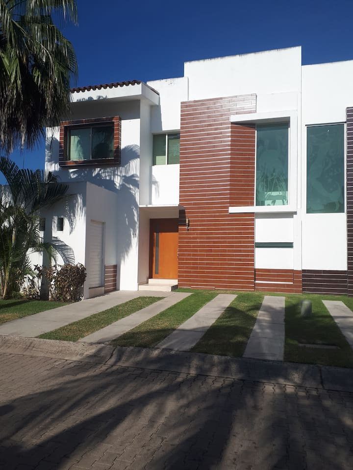Your 3 Bedroom Home steps from beach!