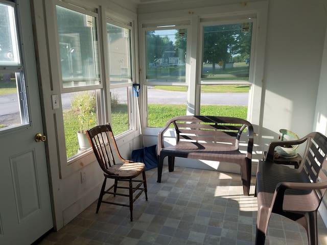screened porch, front door on left, inner door on right