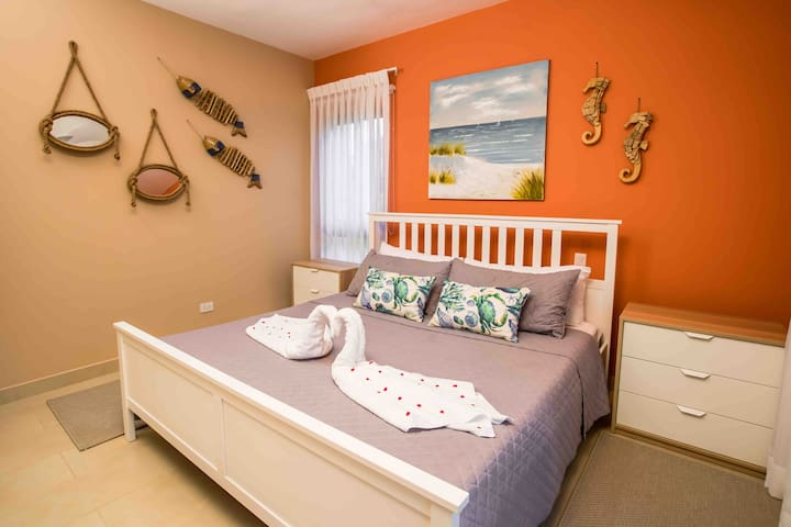 Spacious and comfortable bedroom featuring a king-size bed and Walk-in Closet