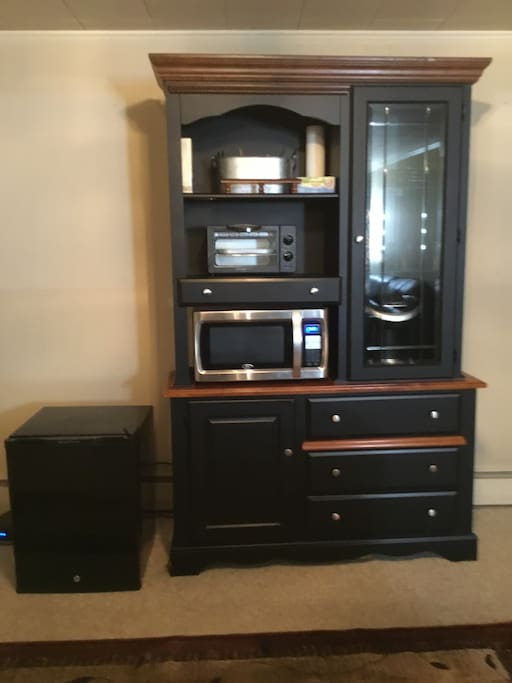 Kitchenette with Keurig,beverages/oatmeal provided,mini-fridge,microwave,toaster oven, and dishes.