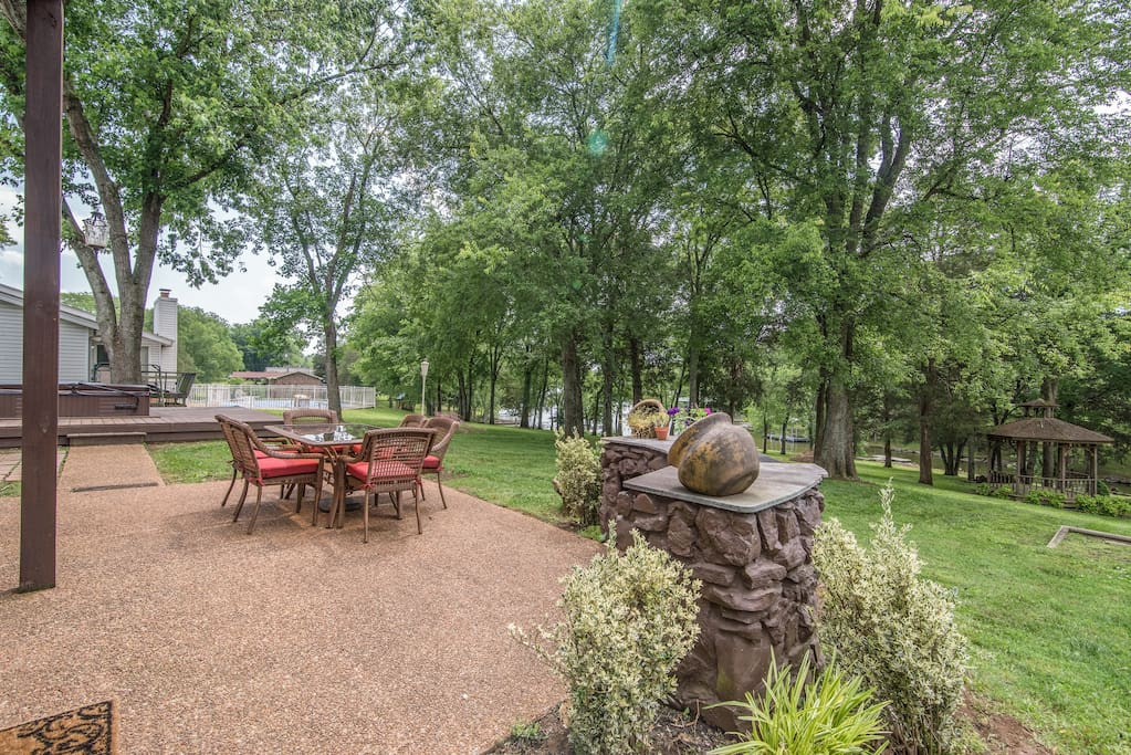 Look out over a sprawling yard from the patio.