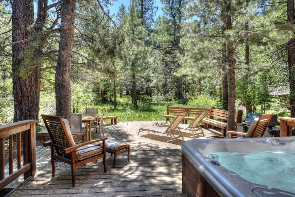 Back deck with a grill, fire-pit, and hot tub