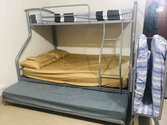 Bunk bed with rollaway and a folding bed.