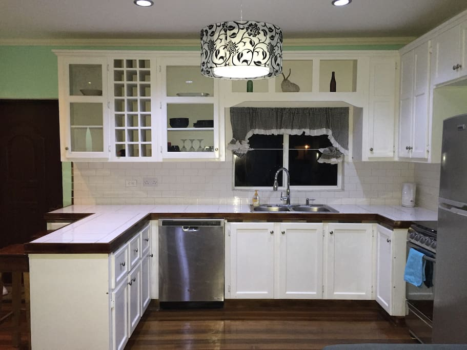 The kitchen is large and completely stocked with amenities.