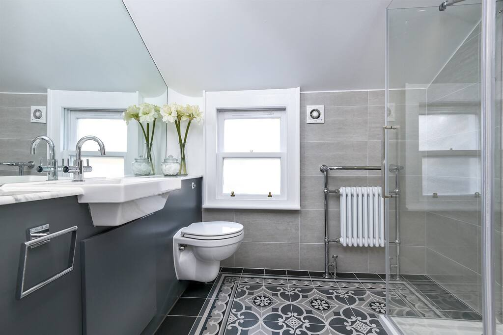Shower off in our classic modern bathroom - serves the Serene and Zen rooms