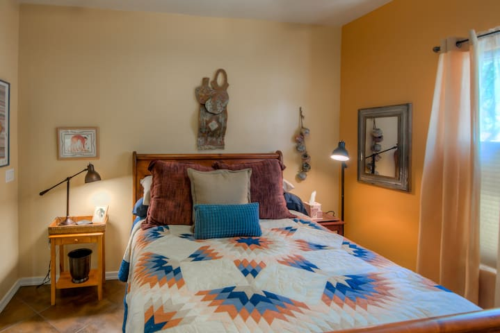 The Spirit of the Southwest Bedroom has Earth Tones with Hints of Reds and Blues.  Upgraded Linens and SMART TV and Ceiling Fan