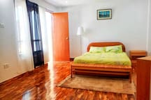 Master bedroom with access to two large balconies. All floorings are luxurious teak parquet floors