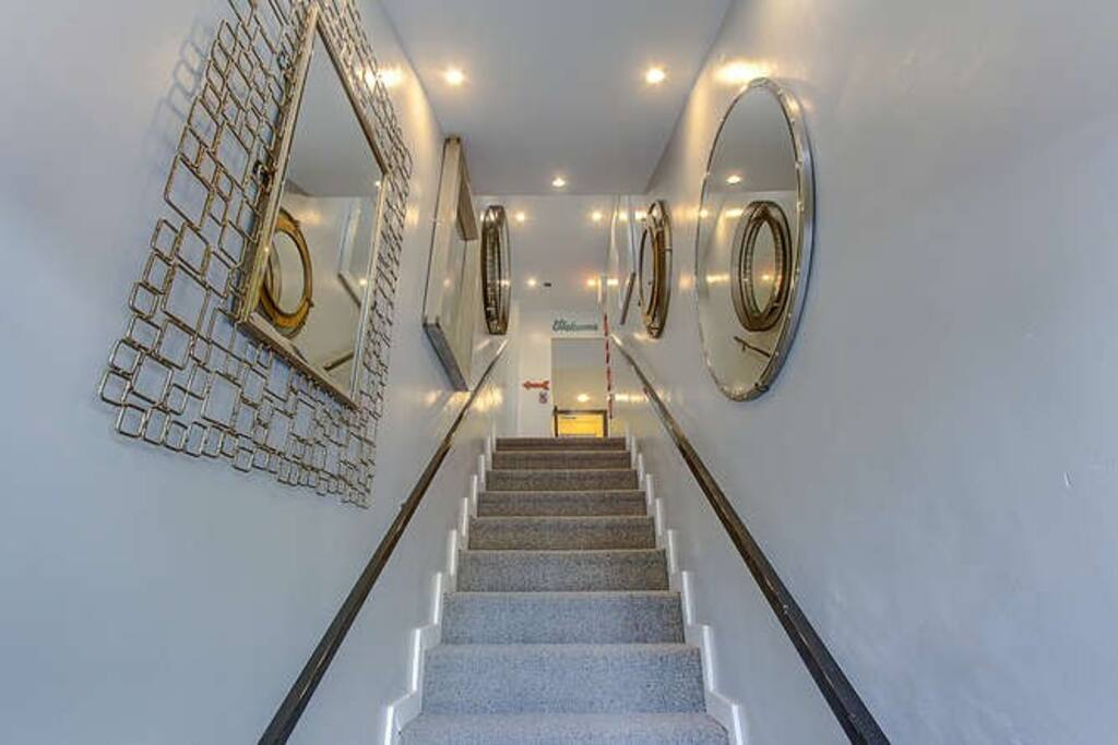 Shared stairway up to suites