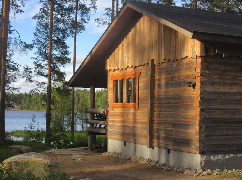Right on the shore of lake Näsijärvi. Traditionally carved from local wood.