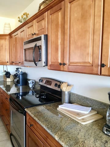 Full Kitchen with granite counter tops and clean steel appliances