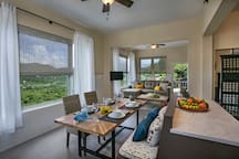 Open floor plan incorporates kitchen, dining, and living spaces