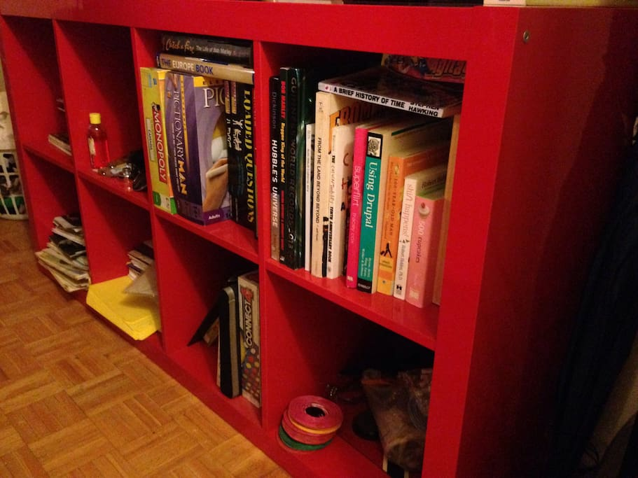 Bookshelf with some board games and nice books to read.