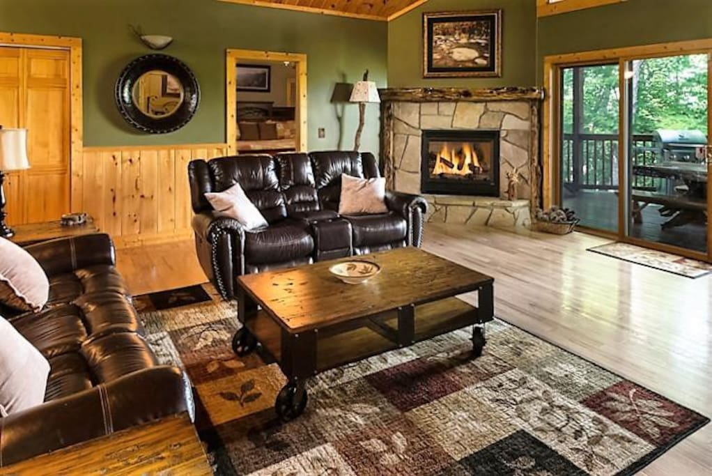 The living area is dedicated to relaxation - Everything about the spacious living room—the power-reclining sofa and love seat, th