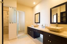 Master bathroom attached to King bedroom with shower & two sinks