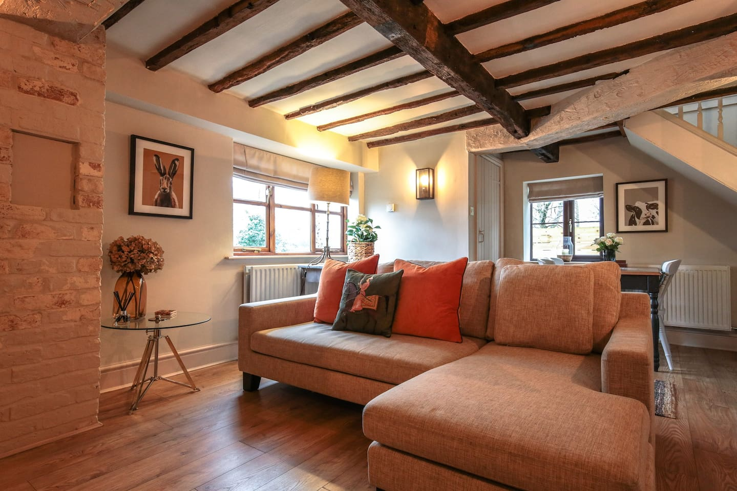Sitting Room with panelled walls, original beams and soft lighting.