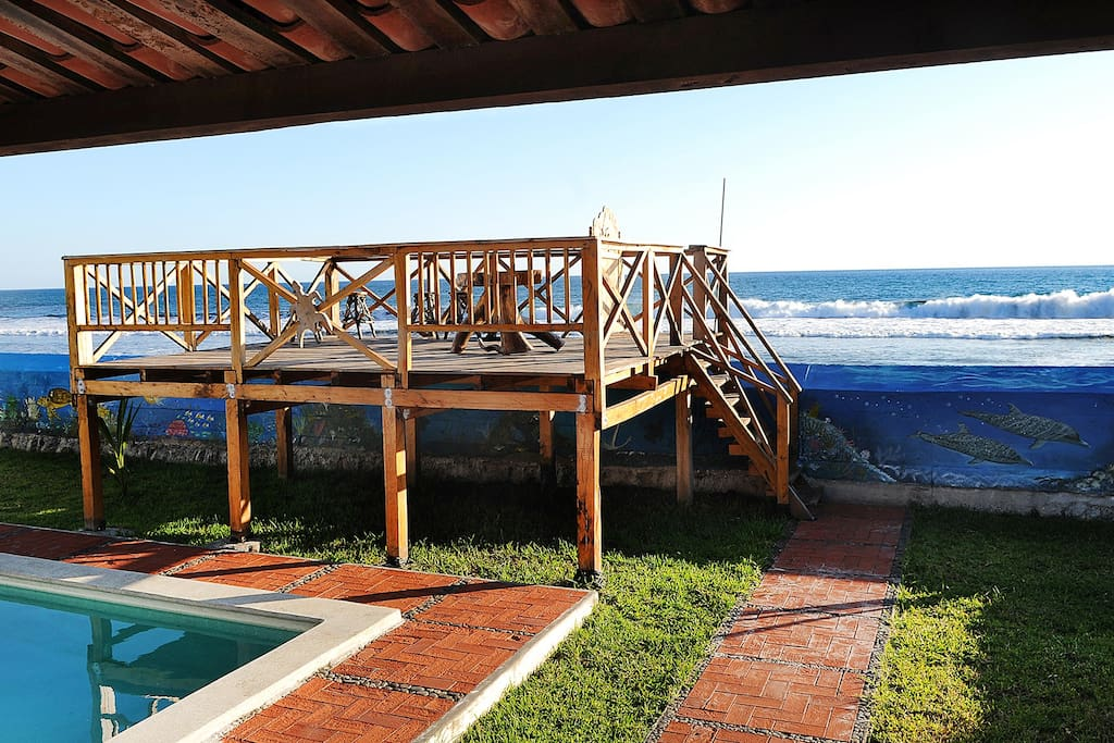 Wooden deck and with the Pacific Ocean in the background