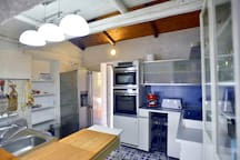 Kitchen with 2 overs, american fridge, espresso coffee maker, toaster, induction hob
