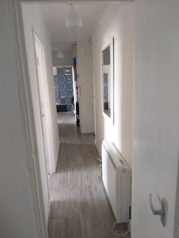 The hallway links the kitchen, bathroom and living room together