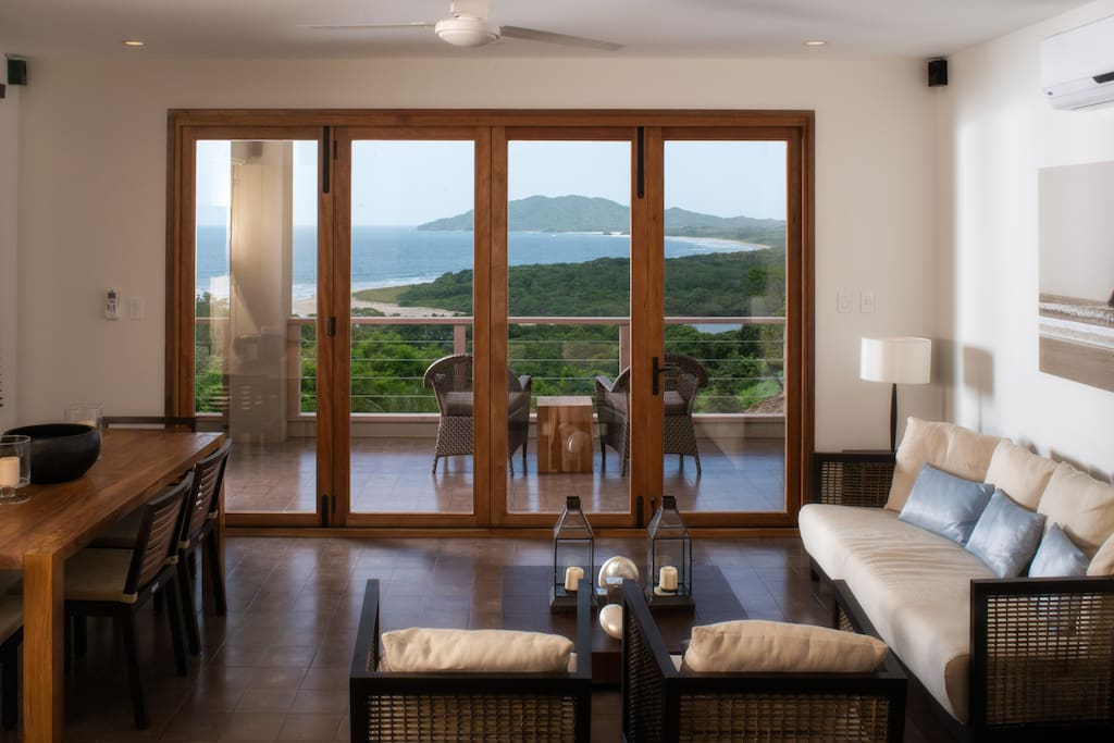 Living room - Living room opens up onto an extended, ocean-view balcony with bi-folding doors