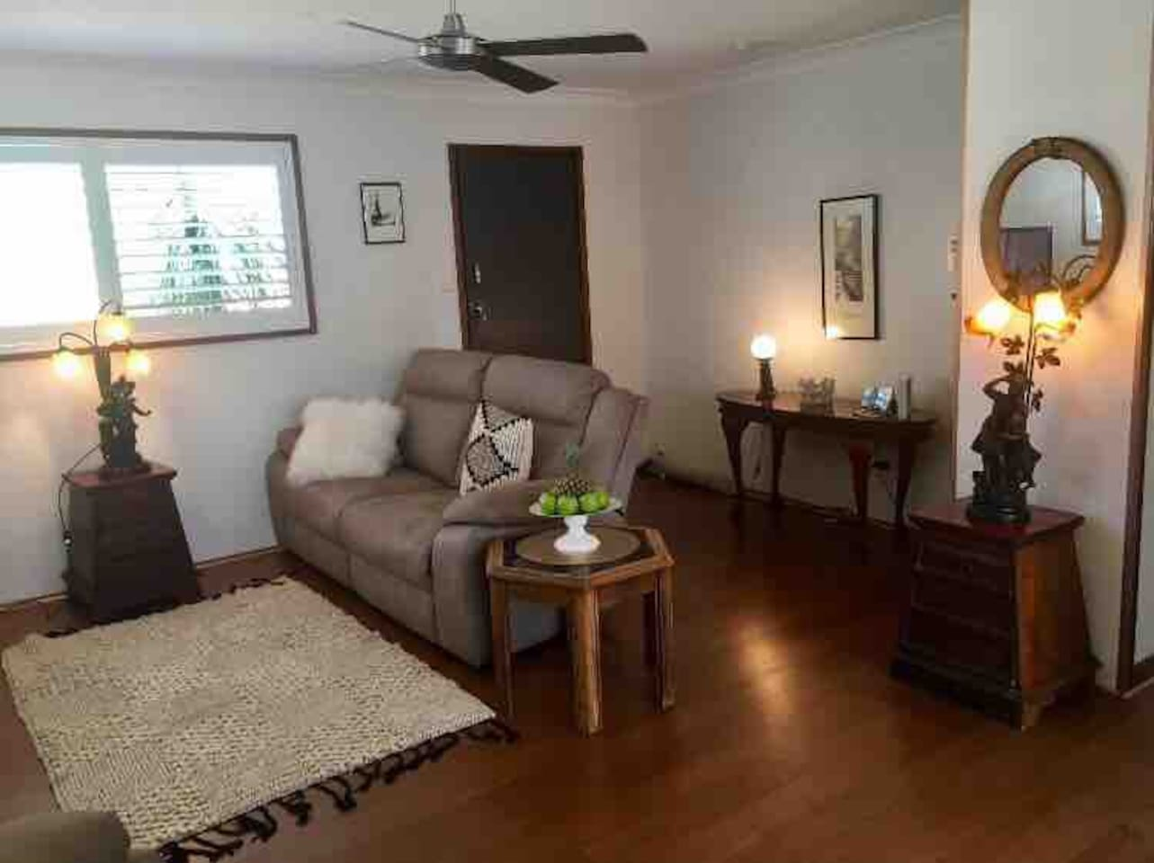 Fully renovated cottage with bamboo flooring,  plantation shutters with stylish eclectic decor.
