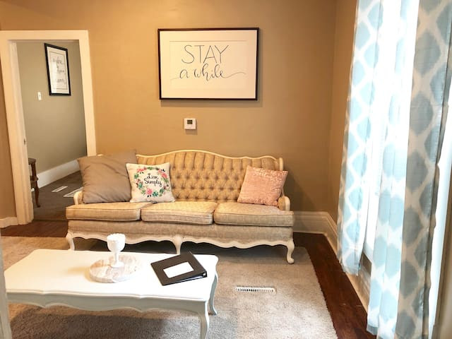 Cute vintage couch with modern throw pillows