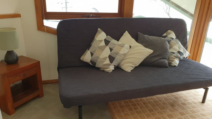 Reading alcove with comfortable queen size sofa bed