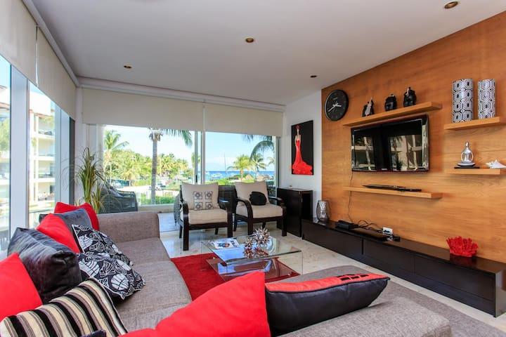 Luxury beach-front Condo with private beach club