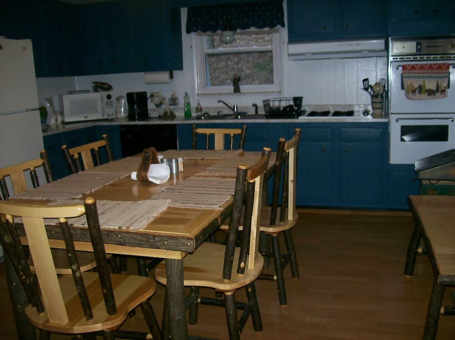 fully equipped kitchen with amish style table, chairs and bench