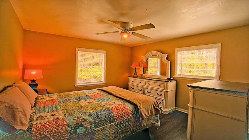 Comfy Queen bed with mirrored dresser, chest, and night stand. The night stand has built in USB charging ports as does the alarm clock, for your convenience. Excellent window views to the Azalea covered property beyond! Wake up to the morning sun!
