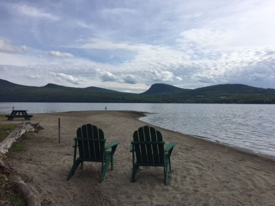 The lake and mountain views on the 400-foot private beach are truly spectacular!