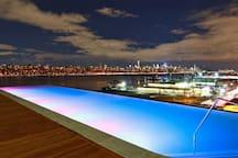 Sojo Spa's infinity pool at night.