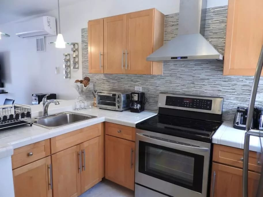 Wow! Eye catching updated kitchen with new appliances and garbage disposal