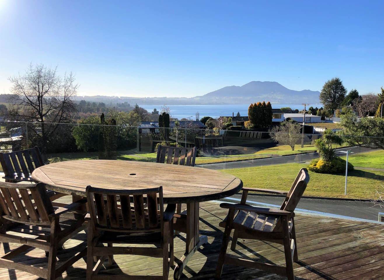 Relax on the sun-soaked deck and take in the beautiful lake and mountain views
